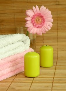 Free Towels, Candles And Pink Gerber. Stock Images - 10256254
