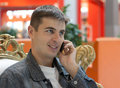 Free Man Smiles With Telephone In Hand Stock Photos - 10262733