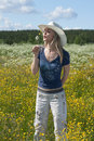 Free Beautiful Girl In Field With Yellow Flower Royalty Free Stock Photography - 10262967