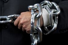Bussinesman Hand With Huge Chain Stock Images