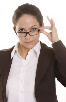 Free Young Woman Looking Over The Top Of Her Glasses Stock Image - 10263661