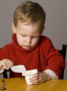 Free Boy Eating Yogurt Stock Images - 10265174