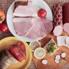 Meat, Salmon, Sausage And Vegetables Stock Photo