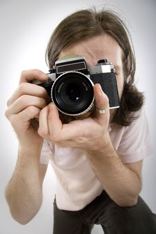 Free Photographer With An Old Film Camera Royalty Free Stock Image - 10267186