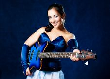 Free Sexy Girl Playing The Guitar Royalty Free Stock Image - 10267236