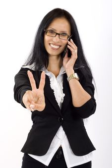 Free Attractive Businesswoman On The Phone Victory Sign Stock Photos - 10267303