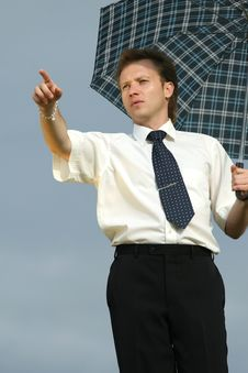 Man With Umbrella Pointing With Finger Stock Image