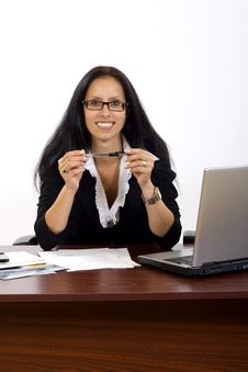 Free Attractive Businesswoman On Her Desk Holding A Pen Royalty Free Stock Photography - 10267977