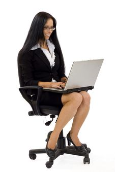 Free Businesswoman With Laptop In Chair Royalty Free Stock Photography - 10267997
