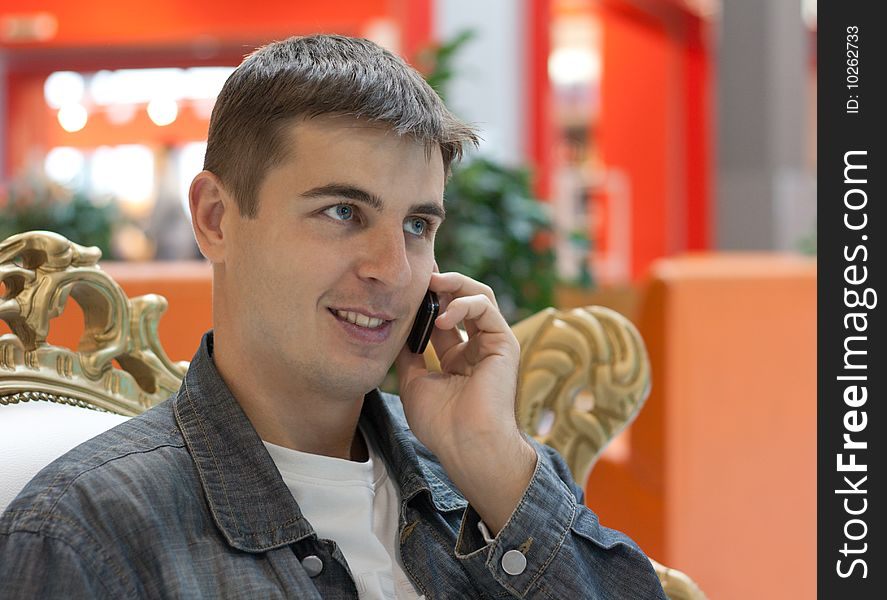 Man smiles with telephone in hand