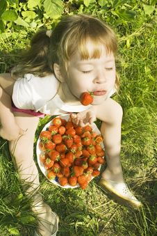 Free Girl Eating Strawberries. Stock Photography - 10273702