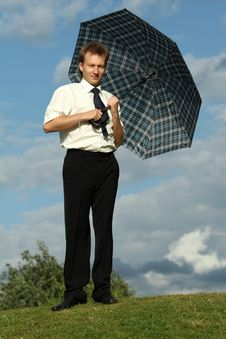 Free Businessman Holding Umbrella Stock Image - 10278071