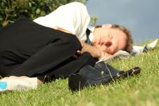Free Businessman Sleeping In Park Stock Images - 10278084