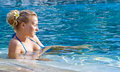 Free Blonde Girl Relaxing In Hotel Pool Royalty Free Stock Photos - 10288558
