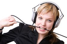 Girl With A Cable Of Earphones Royalty Free Stock Photo