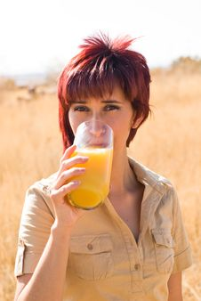 Free WOMAN DRINKS ORANGE JUICE Royalty Free Stock Photography - 10284497