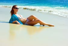 Free Brunette Girl Relaxing On The Beach Stock Photos - 10288473