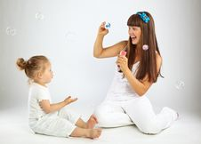 Little Girl And Her Mother Blowing Bubbles Royalty Free Stock Photo