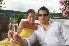 Stylish Couple Having A Drink On Terrace Royalty Free Stock Images