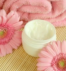 Free Face Cream, Towel And Flowers. Royalty Free Stock Image - 10295056
