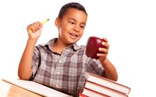 Free Cute Hispanic Boy With Books & Apple Stock Photos - 10295153