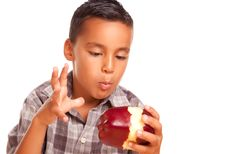 Free Adorable Hispanic Boy Eating A Large Red Apple Royalty Free Stock Photos - 10295188