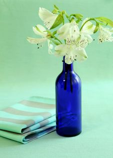 Free Blue Bottle With Flowers And Napkin. Stock Photo - 10295760