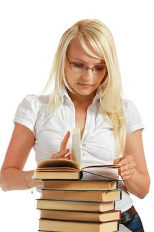 Free Young Girl Leaned Over Pile Of Books Royalty Free Stock Image - 10297866