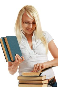 Free Young Girl Leaned Over Pile Of Books Stock Photo - 10297880