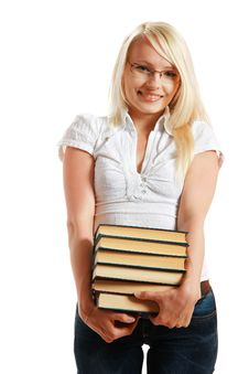 Free Young Girl Leaned Over Pile Of Books Stock Images - 10297894