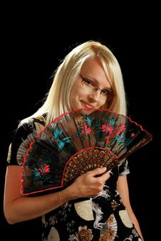 A Young Attractive Woman With Fan Stock Photo