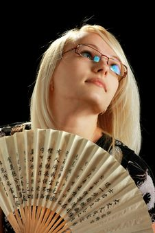A Young Attractive Woman With Fan Royalty Free Stock Photography
