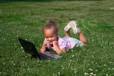 Free Young Girl In Green Grass With Laptop Computer Royalty Free Stock Image - 10298336
