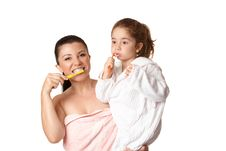 Free Mother And Daughter Brushing Teeth Royalty Free Stock Photography - 10299927
