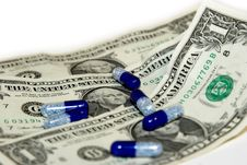 White Blue Pills With One Dollar Bills Stock Photography