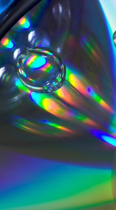 Drop On The CD-disk Stock Images
