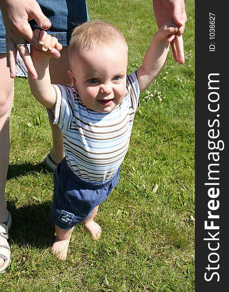 Little Boy learning to walk