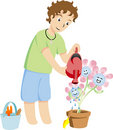 Free Boy Watering Flowers Stock Images - 10309404