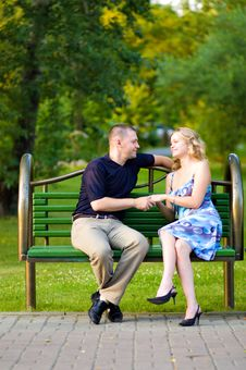 Free Couple In Love Sitting At A Bench Stock Image - 10300071