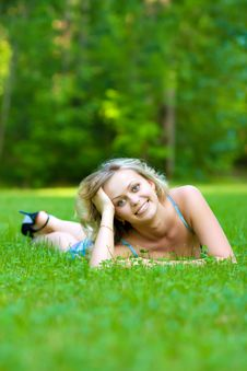 Free Young Woman Lying On A Green Grass Stock Photography - 10300082