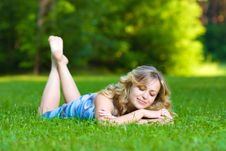 Free Young Woman Lying On A Green Grass Stock Photography - 10300092