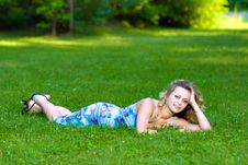 Free Young Woman Lying On A Green Grass Royalty Free Stock Photos - 10300108