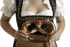 Free Bavarian Girl In Dirndl With Oktoberfest Pretzel Royalty Free Stock Photography - 10306267