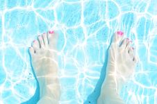 Relaxing Feet In The Pool Royalty Free Stock Images