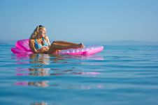 Blonde Girl On Inflatable Raft Royalty Free Stock Photography