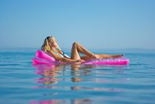 Free Blonde Girl On Inflatable Raft Royalty Free Stock Photos - 10306728