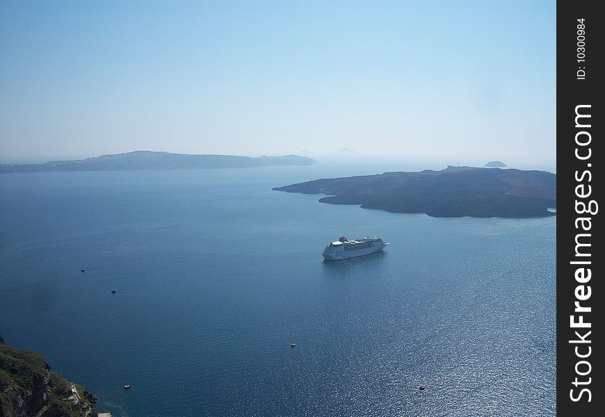 Greek island of Santorini and cruiser