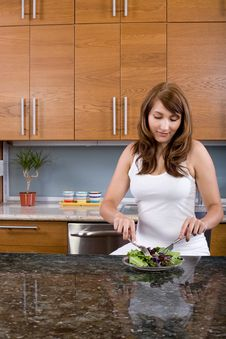 Free Woman Eating A Salad Stock Photography - 10313402