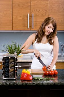 Free Woman Cooking In The Kitchen Stock Photography - 10313752