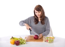 Free Woman Cutting An Apple Stock Images - 10314654
